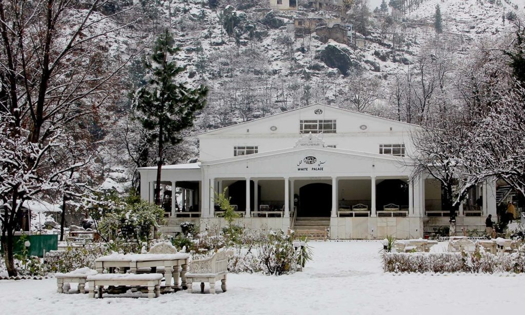 Snow covered White Palace in winter season.