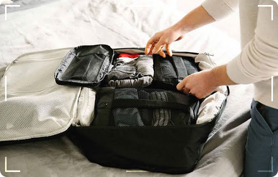 Roll up your clothes for the extra bag space